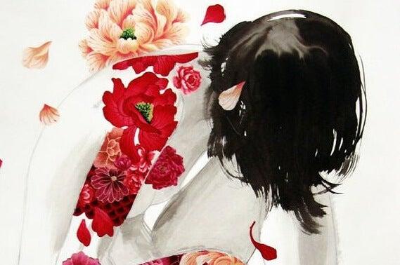Vrouw met bloemen op haar rug die droevig voorover gebogen zit