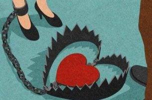Vrouw die is vastgeketend aan een hart, als symbool voor de afhankelijke persoonlijkheidsstoornis