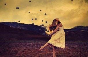 Meisje dat een ballethouding aanneemt