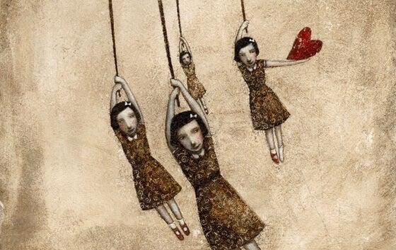 Vier meisjes die zich vasthouden aan een touw en een houdt ook een hartje vast