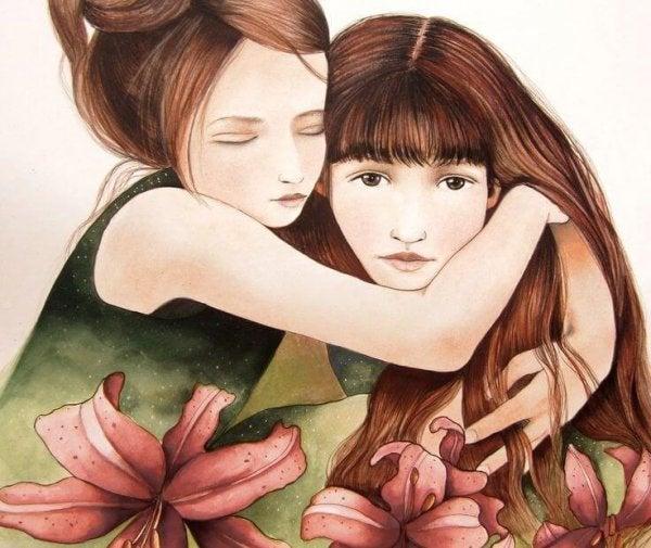 Twee meisjes die elkaar knuffelen en zp hun emoties accepteren