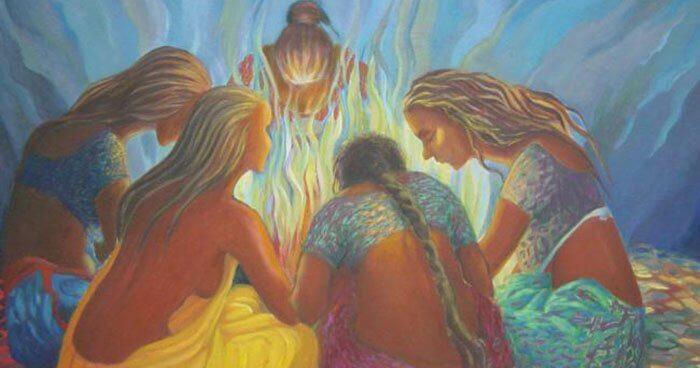 Vrouwen rond een kampvuur