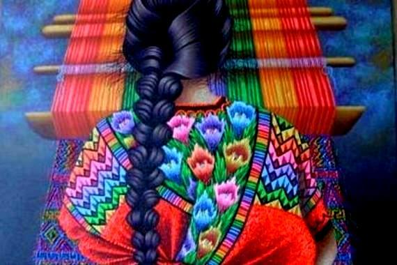 Vrouw die een kleurrijk tapijt weeft