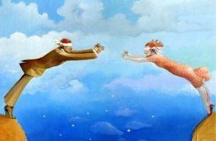 Twee mensen die elkaar geblinddoekt vast proberen te pakken, als symbool voor cognitieve vervormingen in relaties
