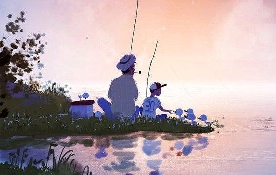 Vader en zoon die samen zitten te vissen