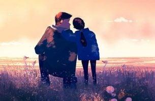 Vader en dochter die uitkijken over een mooi landschap omdat zijn kind heeft leren verliezen