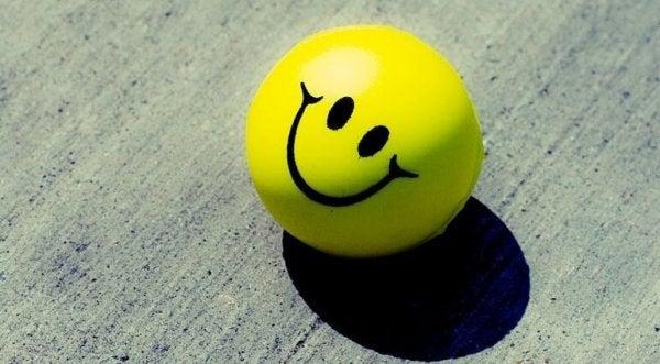 Een smiley die zorgt voor een positieve houding