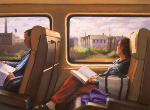 Vrouw die zit te lezen in de trein