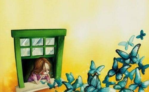 Meisje dealt met alledaags verdriet en laat blauwe vlinders vrij