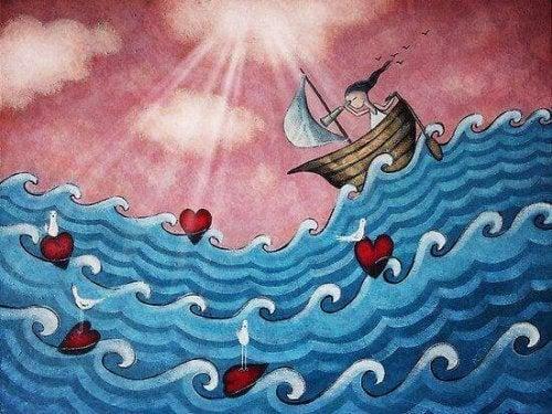 Vrouw op zee met golven van harten