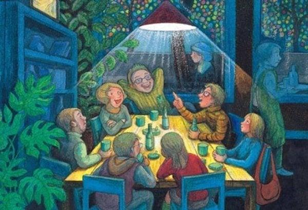 Familiebijeenkomst aan een tafel