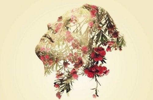 Droevig gezicht met bloemen er omheen