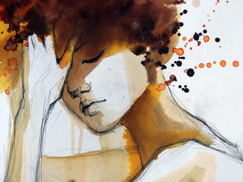 Vrouw denkt na met hand op hoofd