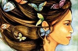 Vrouw die vrolijk wordt van de vlinders in haar haar, maar je bepaalt zelf hoe je met je emoties omgaat