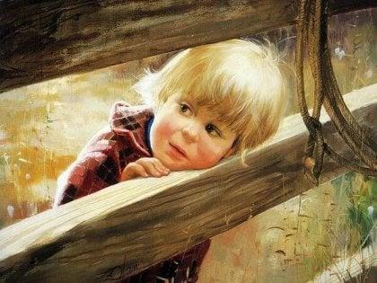 Kind bij een hek