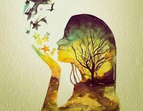 Vrouw die mooie momenten creeert door sterren en vogels weg te blazen