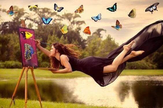 Schilderende vrouw met vlinders