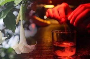 Persoon die scopolamine in een glas doet