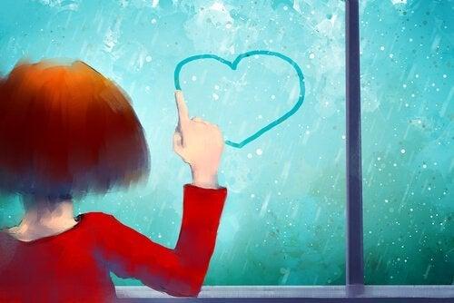 Teken een hart op het raam