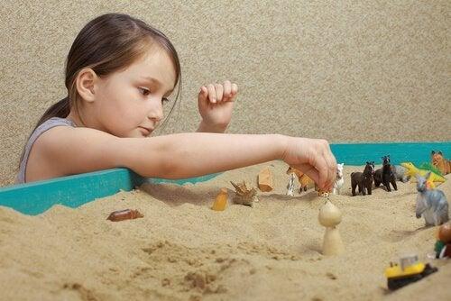 Zandbaktechniek met een kind