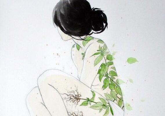 Meisje met boombladeren op haar huid.