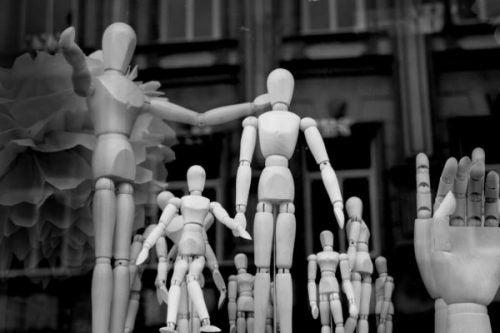groep houten poppen