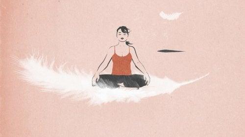 Meisje mediteert op veer