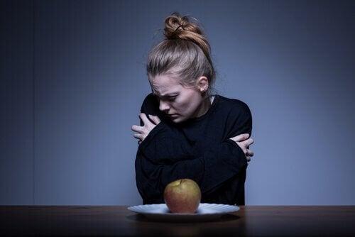 Vrouw met een negatief lichaamsbeeld