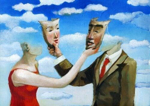 Twee mensen die elk een masker dragen