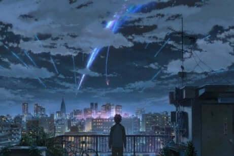 Iemand kijkt naar vallende kometen in een animatiefilm